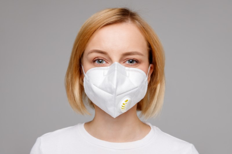 Woman with blonde hair and mask on