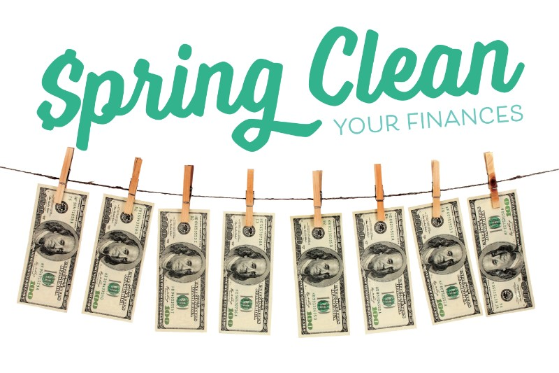 spring clean your finances-$100 bills hanging on a clothesline with clothespins
