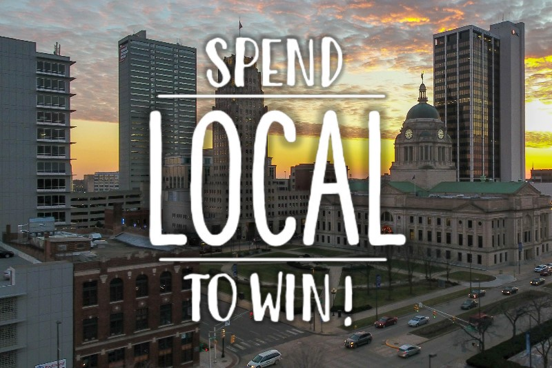 photo of downtown fort wayne with spend local to win text