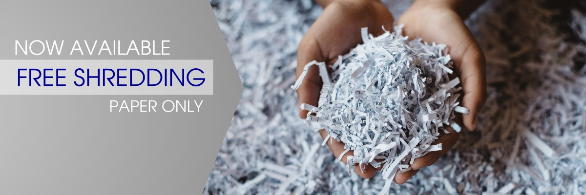 free shredding now available- photo with hands holding paper shredding