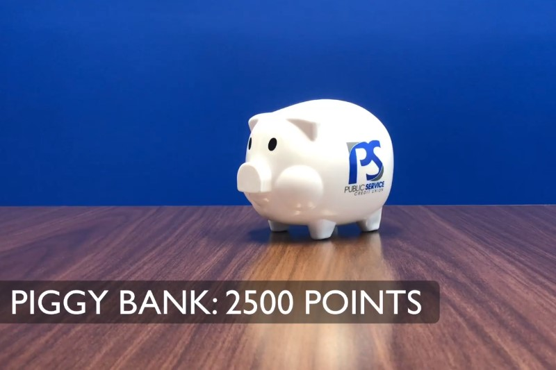 photo of PSCU white piggy bank with blue and grey logo- 2500 points